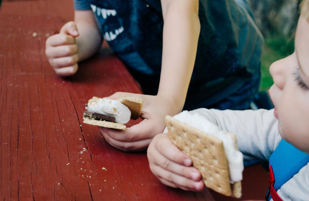 two children eating smores