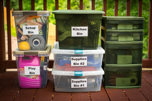 camping supplies packed in labeled totes